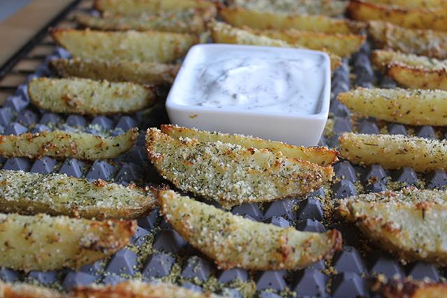 Patatas asadas al horno con ajo y queso proteínico en polvo